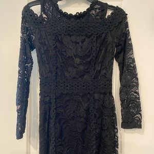 Short black lace dress with peek-a-boo shoulders